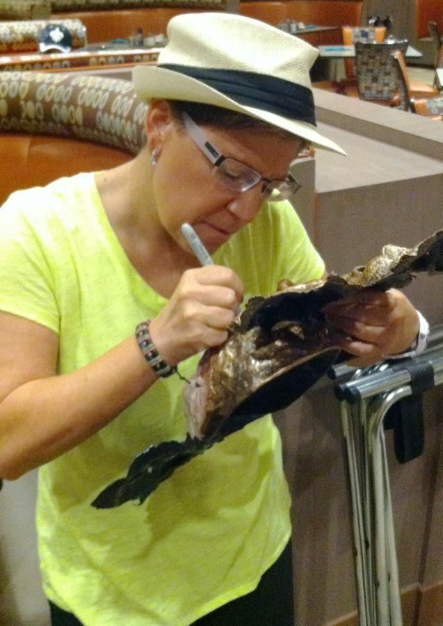 Carla signing mask