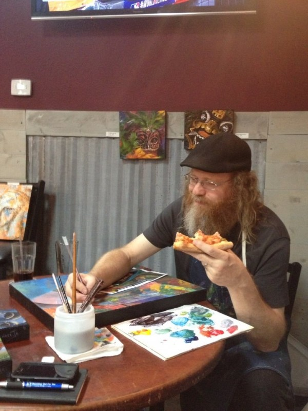 Don painting n eating pizza